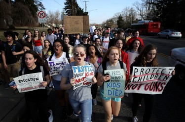 SILVER SPRING, MD - FEBRUARY 21: Students from Montgomery Blair High School march down Colesville Road in support of gun reform legislation February 21, 2018 in Silver Spring, Maryland. In the wake of last week's shooting in Parkland, Florida, where 17 people were killed, the students planned to take public transportation to the U.S. Capitol to hold a rally demanding legislation to curb gun violence in schools. (Photo by Win McNamee/Getty Images)